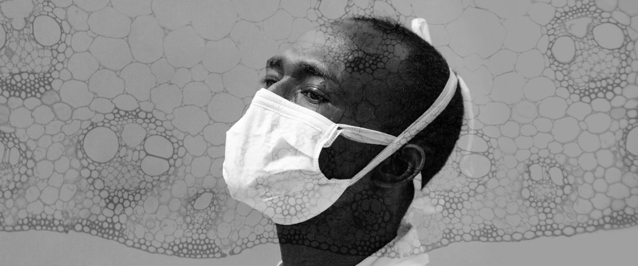 Profile image of a Black masculine-appearing person wearing a mask.
