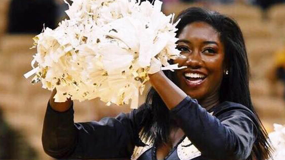 Camille Sturdivant dances with pompoms